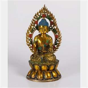 A Tibetan Painted Brass Figure of Buddha holding a