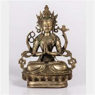 A Tibetan Cast Silvered Brass Figure of