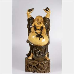 A Chinese Buddha of Wealth and Prosperity Statue