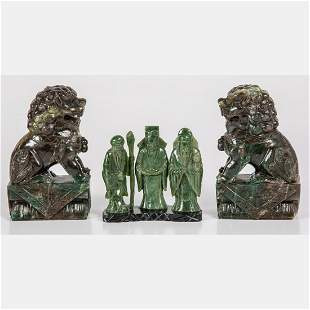 A Group of Chinese Jade Deities and Buddhistic Lions
