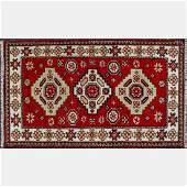 An Indo Caucasian Kazak Wool Rug, 20th Century.