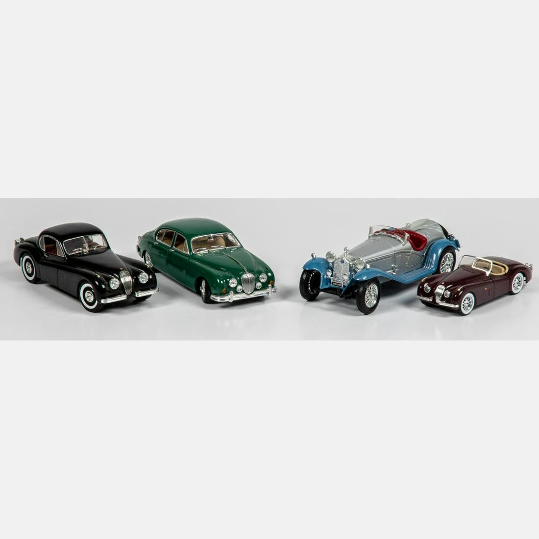 Four 1:18 and 1:24 Scale Model Cars