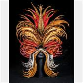 A John Flemming Leather Mask on Stand, 20th Century,