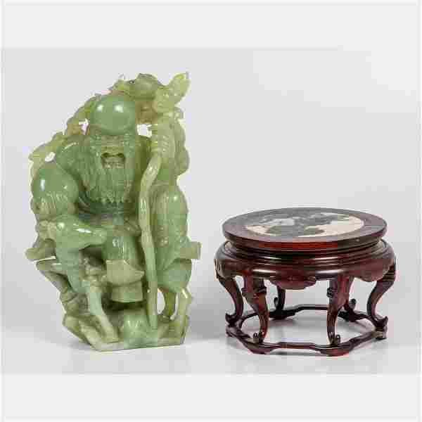 A Chinese Carved Celadon Jade Figural Group Depicting