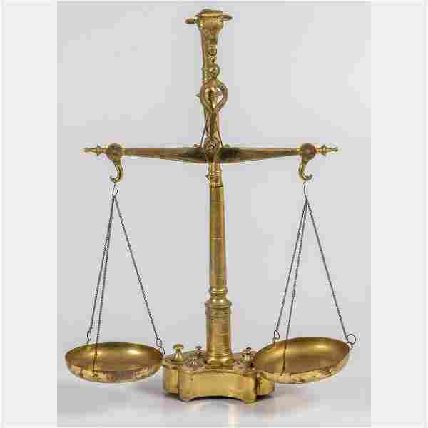 An Antique Brass Scale with Weights, 19/20th Century.