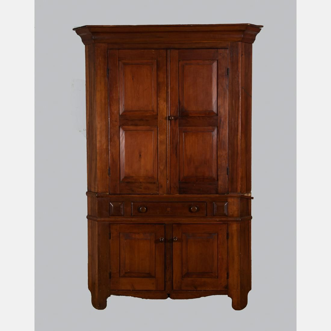 An American Pine Corner Cupboard, 19th Century.
