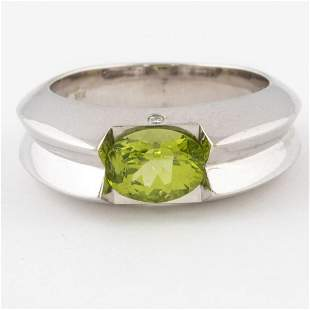 An 18kt White Gold Peridot and Diamond Ring