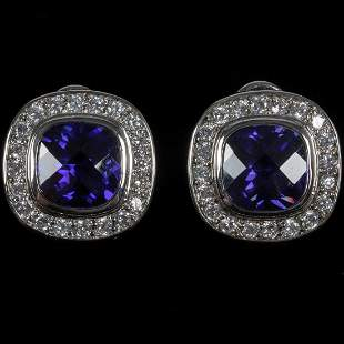 A Pair of Sterling Silver Tanzanite and Clear Stone