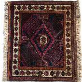 An Antique Persian Balouch Wool Rug, 20th Century.