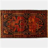 A Persian Balouch Wool Rug, 20th Century.