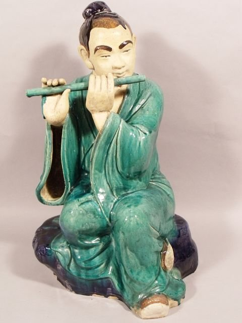 15: A Chinese Earthenware Figure of a Boy Playing the F