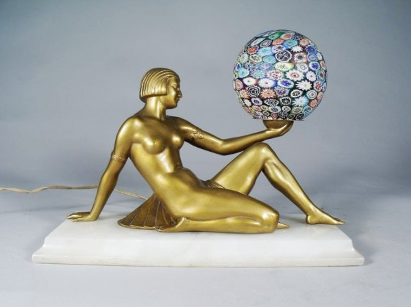 18: An Art Deco Style Figural Gilt Metal and Glass Lamp
