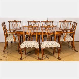 A Chippendale Style Walnut Dining Table with Eight