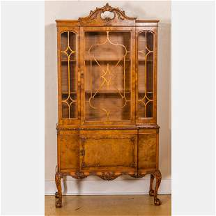 A Chippendale Style Walnut Cabinet, 20th Century.