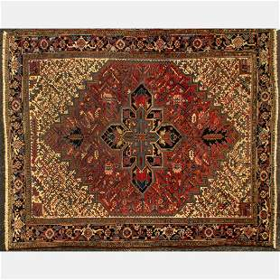 An Antique Persian Heriz Wool Rug, Early 20th Century.