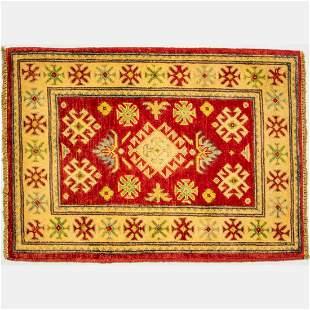 An Afghani Caucasian Kazak Wool Rug, 20th Century.