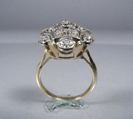 1: A 14 kt Yellow and White Gold Diamond Melee Ring,
