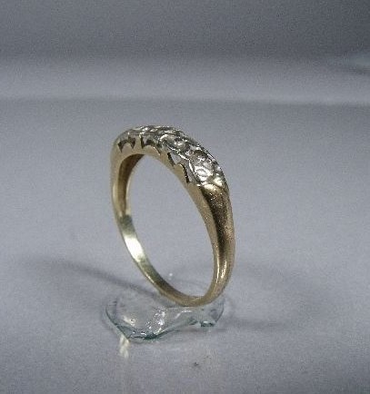 3: A 14 kt Yellow and White Gold Ring,