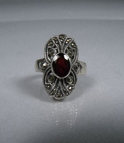 5: A Sterling Silver Garnet and Marcasite Ring,