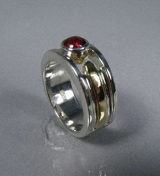6: A Sterling Silver and Gold Vermeil Garnet Ring,