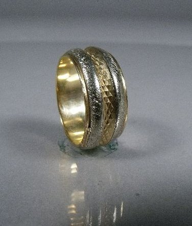12: A 14 kt Yellow and White Gold Band,