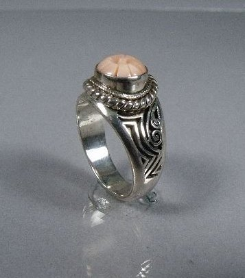 13: A Sterling Silver and Pink Coral Ring,