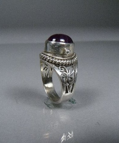 14A: A Ladies Silver and Amethyst Ring with Secret Comp