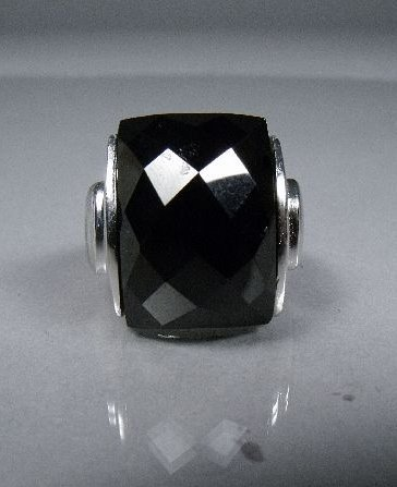 23: A Stering Silver and Black Onyx Ring,