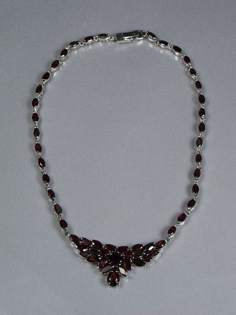 59: A Sterling Silver and Garnet Necklace,