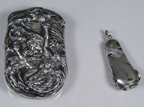 128: A Sterling Silver Matchcase together with a Serlin