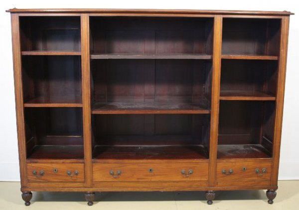 1: A Georgian Style Mahogany Three Part Bookcase with D