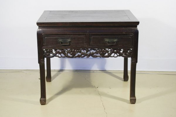 9: A Chinese Stained Elm Two Drawer Table.