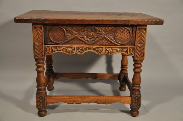 12: A 17th Century Spanish Carved Walnut Low Table with