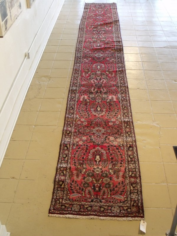 4: An Antique Persian Wool Runner.