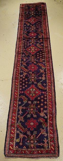 5: An Antique Turkish Oushak Wool Runner.