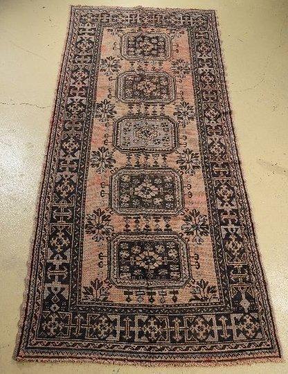 8: An Antique Turkish Oushak Wool Runner.