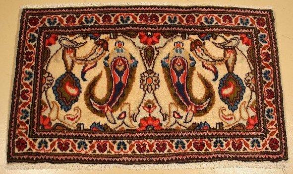 11: A Persian Sarouk Wool Rug.