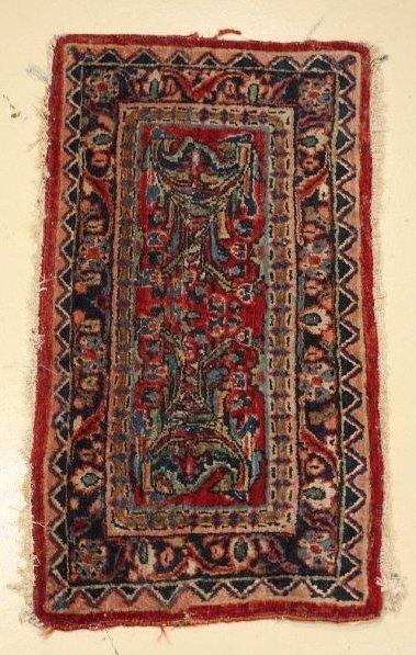 15: An Antique Persian Sarouk Wool Rug.