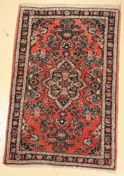 16: An Antique Persian Dargazine Wool Rug.