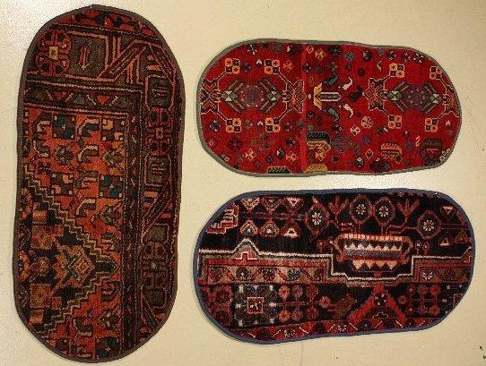 17: A Group of Three Persian Wool Mats.