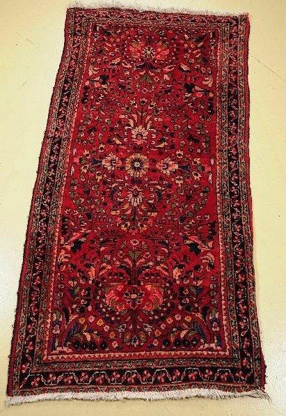 18: An Antique Persian Sarouk Wool Rug.