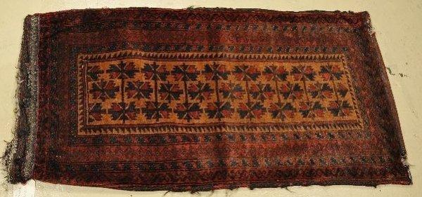 20: An Antique Persian Baluch Wool Saddle bag.