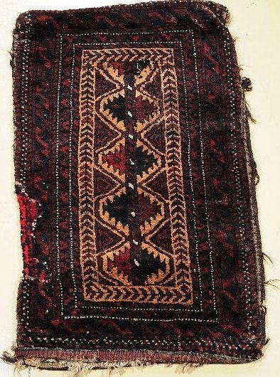 21: An Antique Persian Baluch Wool Saddle Bag.