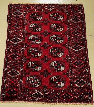 23: An Antique Turkoman Wool Rug.