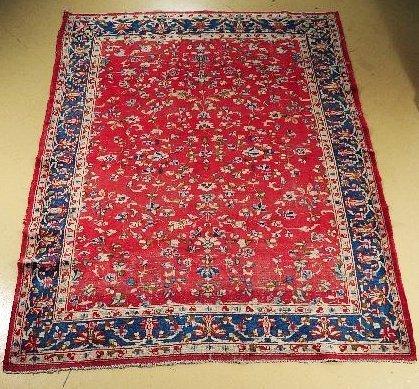 64: A Persian Kirman Wool Rug.