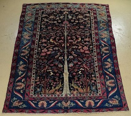 102: An Antique Persian Khorasan Wool Rug.
