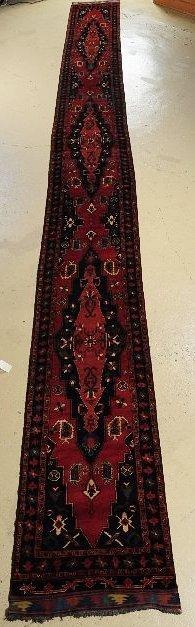 261: A Semi Antique Afghan Caucasian Wool Runner.