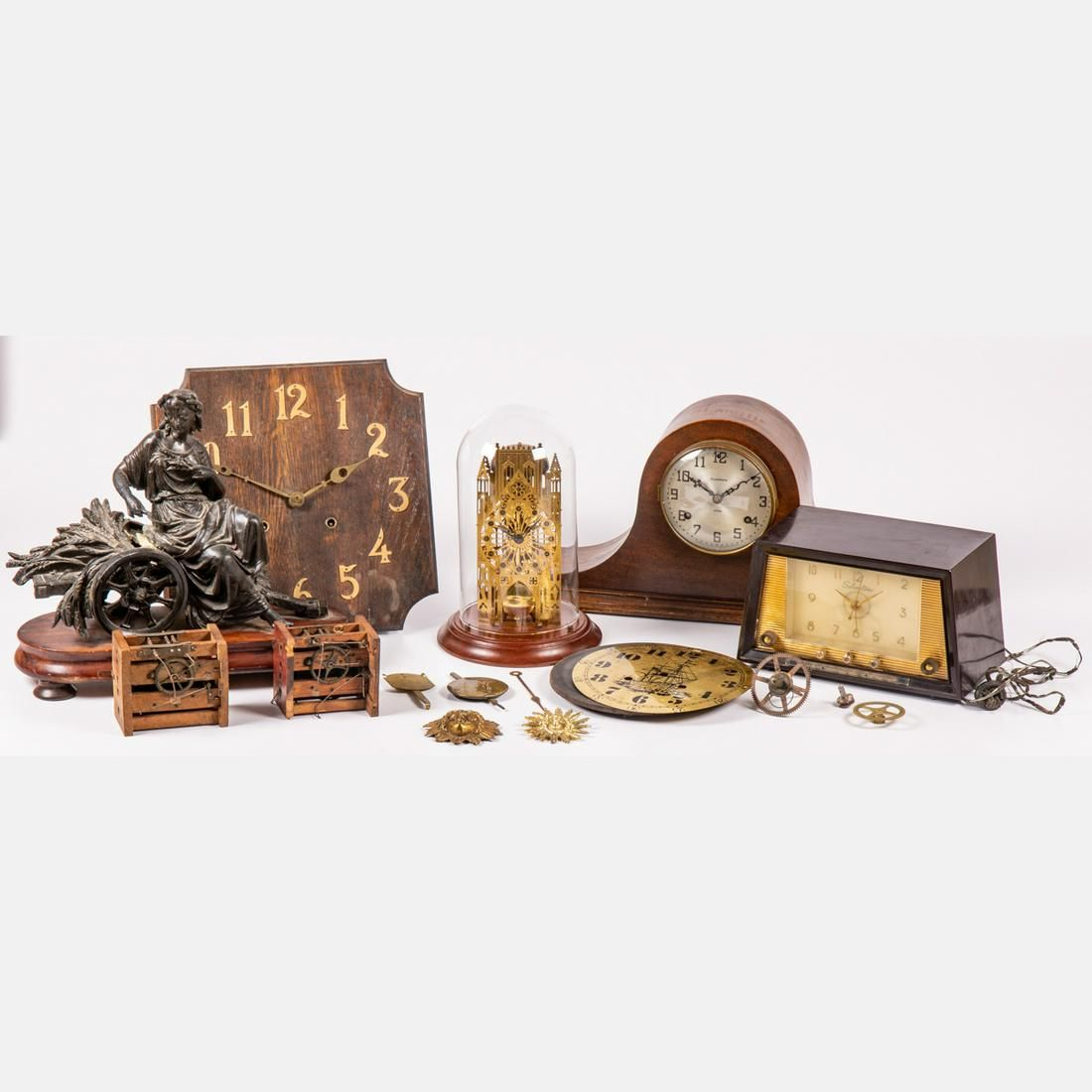 A Miscellaneous Collection of Clocks and Clock Parts,