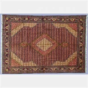 A Persian Tabriz Wool Rug, 20th Century.