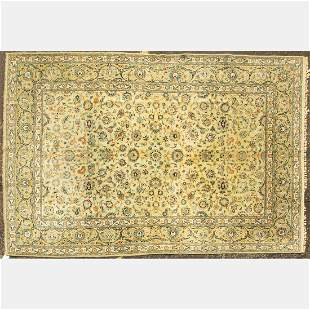 A Persian Kashan Wool Rug, 20th Century.